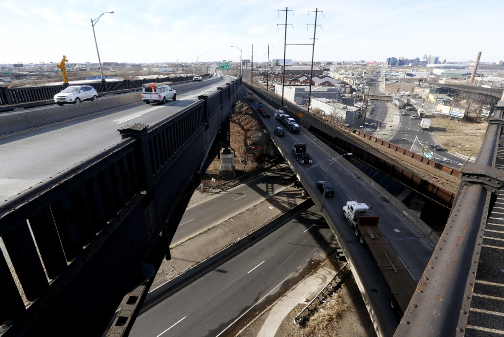 Commuters on the Pulaski Skyway (center R), just before the Holland Tunnel entrance, Thursday, in Jersey City, N.J. Transportation officials say a major northern New Jersey roadway will be shut down beginning February 2014 for a two-year renovation. (AP Photo/Julio Cortez)