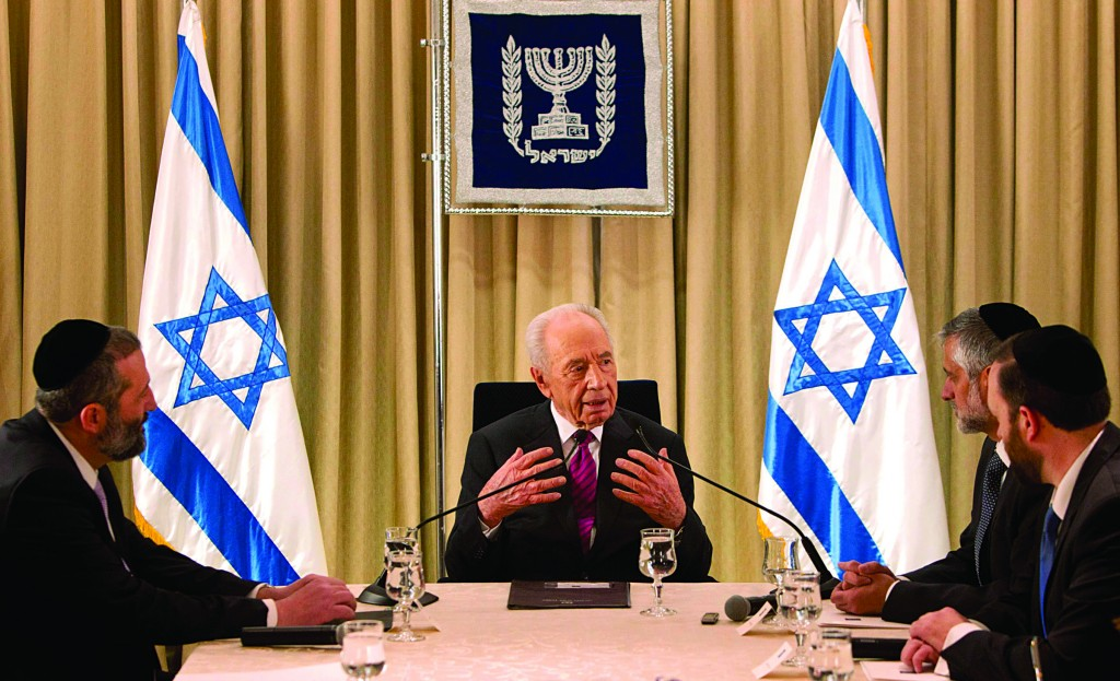 Israel's President Shimon Peres (C) meets with (L-R) Rabbis Aryeh Deri, Eli Yishai and Ariel Attias of Shas, who reportedly joined Likud-Beiteinu, Yesh Atid, Jewish Home, Kadima and UTJ in nominating Prime Minister Binyamin Netanyahu to form a new government. (REUTERS)