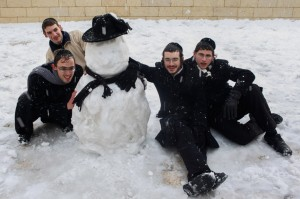 Posing for a photograph near a snowman in the Old City on Thursday. (FLASH90)
