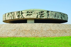 """A gigantic, circular mausoleum at the Majdanek memorial site stands at the end of the former """"black path"""" to the crematorium. The structure covers a huge mound of ashes. (shutterstock)"""
