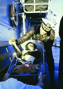 Ham, a chimpanzee astronaut that flew aboard the Mercury-Redstone 2 spacecraft, is greeted by Commander Ralph A. Brackett after being recovered after a flight at sea. (NASA via Getty Images)