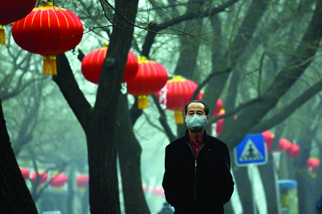 A man wearing a mask walks along a street on a heavy hazy day during winter in central Beijing, January 30, 2013. Beijing temporarily shut down 103 heavily polluting factories and took 30 percent of government vehicles off roads to combat dangerously high air pollution, state media reported on Tuesday, but the capital's air remained hazardous despite the measures. (REUTERS/Jason Lee)