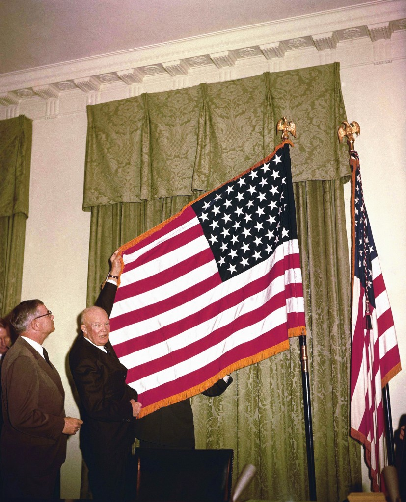 Dwight D. Eisenhower shown with others in a ceremony making Alaska the 49th state on January 3, 1959. Also note the restyled American flag to include a 49th star for Alaska. (AP Photo)