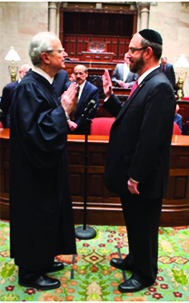 State Senator Simcha Felder (R) is administered the oath of office by the chief judge of the state of New York at the Capitol on Wednesday, January 9.