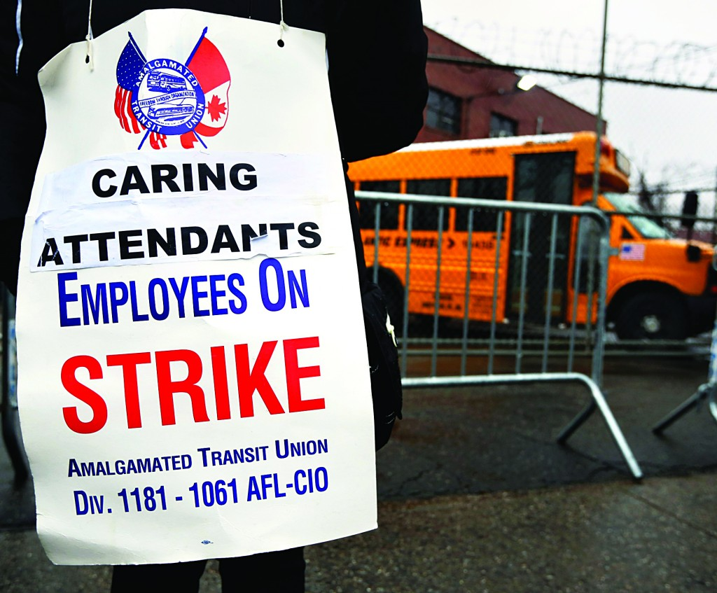 A New York City bus driver stands on strike outside a bus depot in the Queens borough of New York. (REUTERS/Shannon Stapleton)