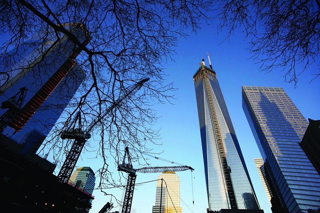 One World Trade Center, right, towers above construction cranes working at the site, Monday in New York. Tuesday will mark the 20th anniversary of the terrorist bombing beneath the World Trade Center that killed six people. (APPhoto/Mark Lennihan)