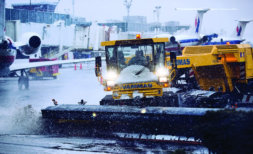Grounds crews clear the tarmac at LaGuardia Airport in New York Friday. (AP Photo/Frank Franklin II)