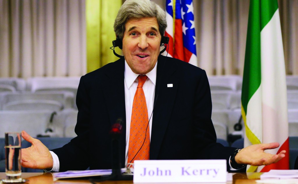 U.S. Secretary of State John Kerry, who speaks several languages, jokes about needing headphones to listen to Italian during an event with Italian Foreign Minister Giulio Terzi at the Ministry of Foreign Affairs in Rome, Thursday. (REUTERS/Jacquelyn Martin/Pool)