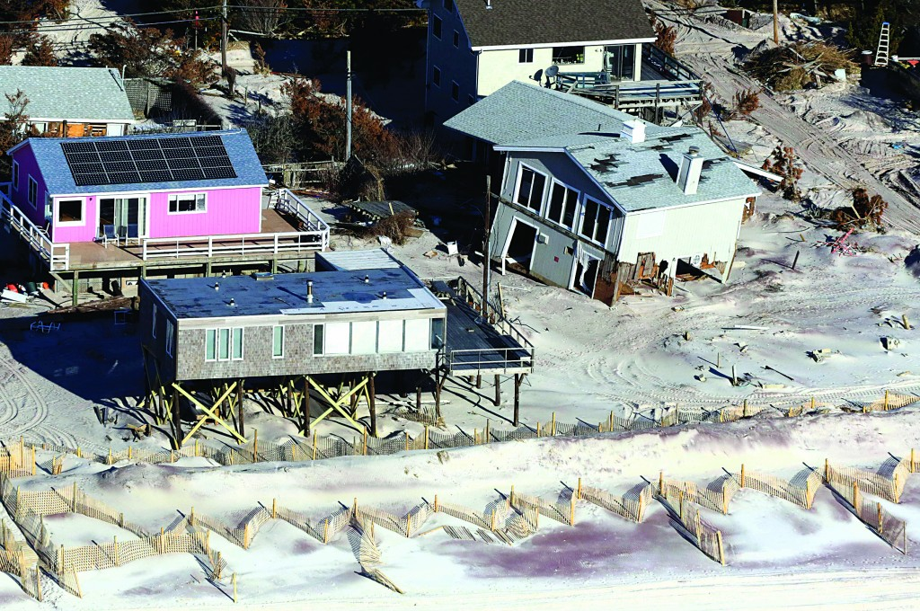 This Friday, Jan. 18, 2013 aerial file photo shows oceanfront homes on New York's Fire Island, damaged when Superstorm Sandy struck on Oct. 29, 2012. (AP Photo/Mark Lennihan)