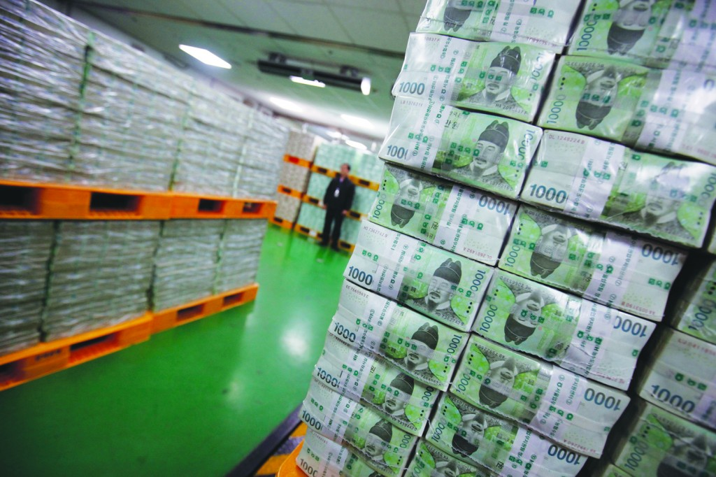 An employee standing amongst stacks of South Korean won for delivery to commercial banks at the Bank of Korea's headquarters in Seoul on Tuesday. Cash demand usually picks up ahead of the Lunar New Year holiday, which begins on February 10, as companies give out special cash bonuses to their employees and parents give money to their children. (Kim Hong-Ji/AFP/Getty Images)