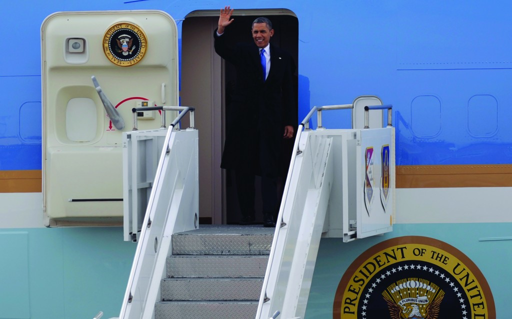 President Barack Obama waves upon his arrival at the Minneapolis St. Paul Airport, Air Reserve Station in St. Paul, Minn., Monday. (AP Photo/Hannah Foslien)