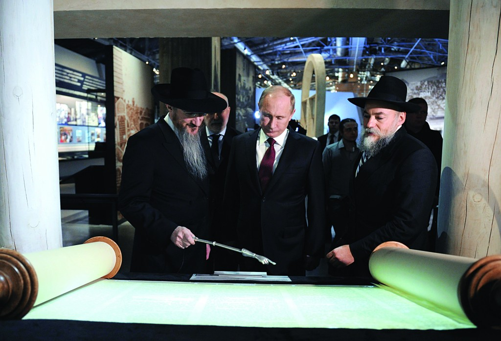 Russian President Vladimir Putin (C) accompanied by Chairman of Federation of Russia's Jewish Organizations Alexander Boroda (R) and Russia's Chief Rabbi, Rabbi Berel Lazar (L) visits the Jewish Museum and Tolerance Center in Moscow, Tuesday. Second left in the back is Skolkovo Foundation Head Viktor Vekselberg. (AP Photo/RIA-Novosti, Alexei Druzhinin, Presidential Press Service)