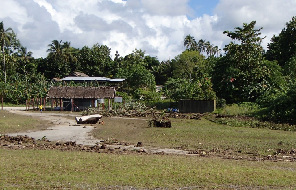 Debris litters the partially destroyed Lata Airport, Solomon Islands, following a Tsunami Wednesday. (AP Photo / World Vision)