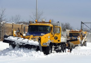 A New York State Department of Transportation plow is dug out of the snow after being stuck near Exit 60 eastbound on the Long Island Expressway, in Ronkonkoma, N.Y. (AP Photo/Kathy Kmonicek)
