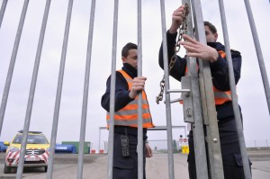 Airport security guards secure an entrance to the tarmac at Zaventem International Airport near Brussels Tuesday. (REUTERS/Eric Vidal)