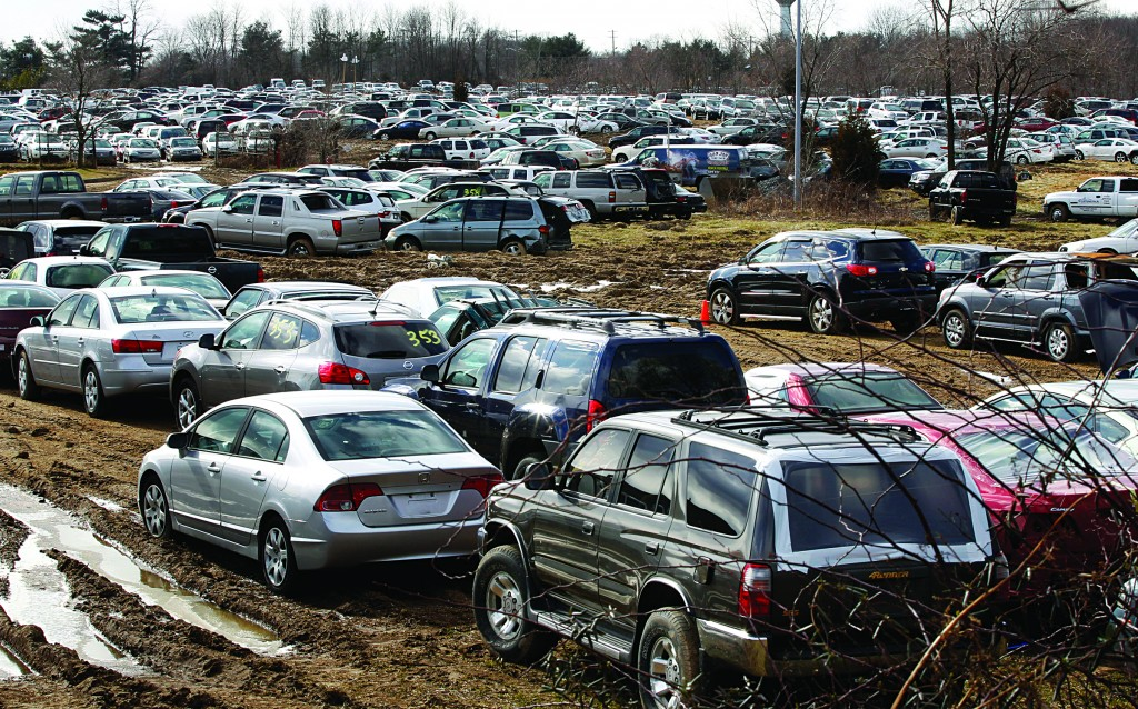 Thousands of storm-damaged and water-logged cars, ruined by Superstorm Sandy, are parked in a 22-acre field in Mansfield, N.J. Officials in the southern New Jersey town say the facility there cannot continue to store 2,400 cars damaged in Superstorm Sandy. (AP Photo/Mel Evans)