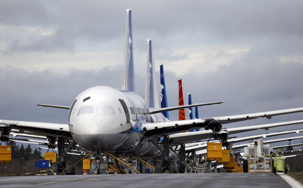 A line of Boeing 787 jets are parked nose-to-tail at Paine Field, in Everett, Wash. (AP Photo/Elaine Thompson)