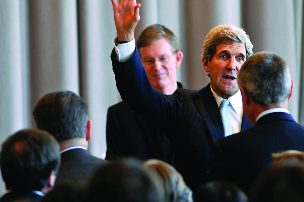 """Sen. John F. Kerry waves to crowd as he arrives at a college in Worcester, Mass., for his """"Thank You"""" event Thursday. (Worcester Telegram & Gazette/AP)"""