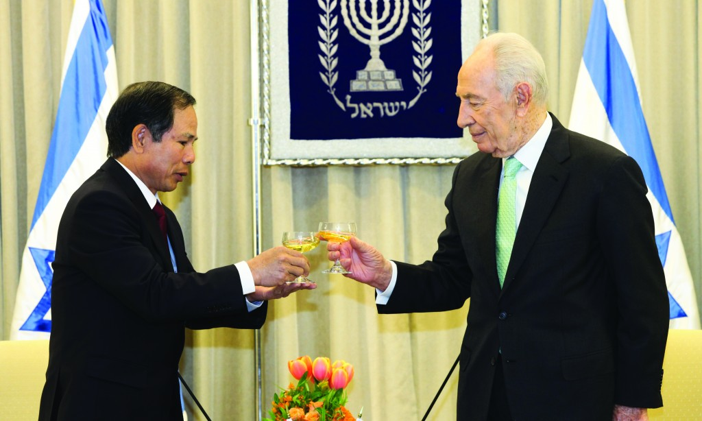 "Incoming Vietnam ambassador to Israel, His Excellency Mr. Ta Duy Chinh, is welcomed by Israeli President Shimon Peres at the President's House on Thursday. Five ambassadors — from Vietnam, Sri Lanka, South Africa, Chile and Zambia — took up their duties on Thursday after presenting their credentials to the president. The new Vietnamese ambassador thanked Peres for improved relations between their two countries, particularly in the fields of agriculture and technology. President Peres responded and said, ""There are 300 students from Vietnam in Israel who came here to learn about modern agriculture. This is a unique project which benefits both countries."" (FLASH90)"