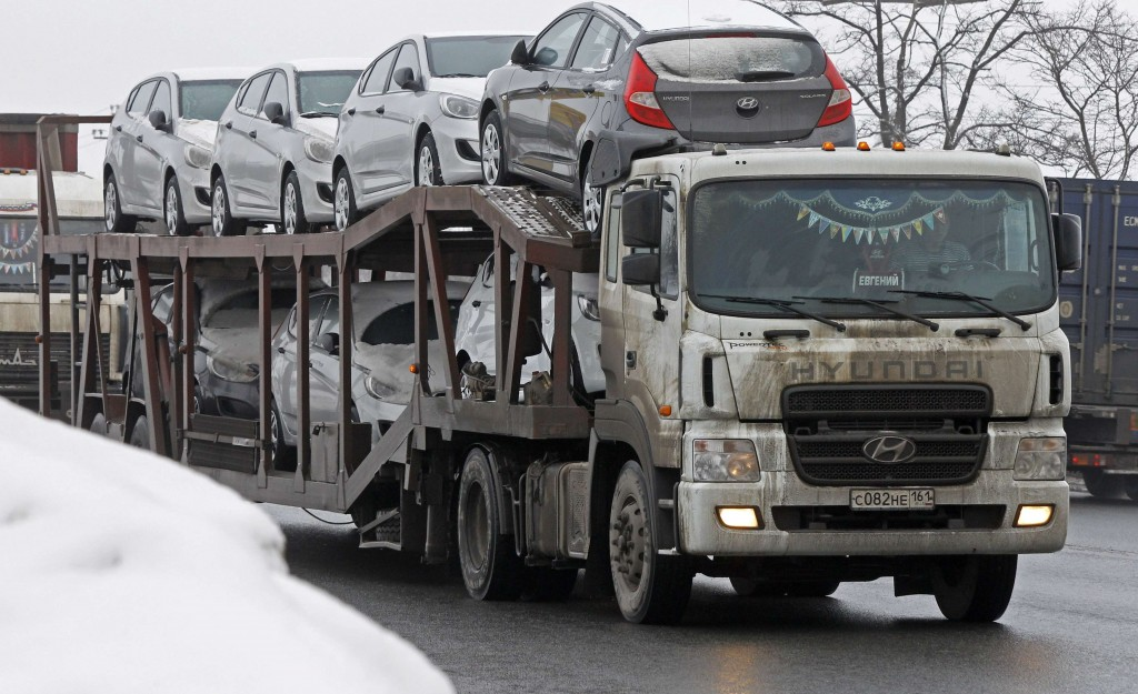 A truck with a trailer transports new Hyundai automobiles on a highway leading from Moscow, outside St. Petersburg, February 6, 2013. (REUTERS/Alexander Demianchuk)