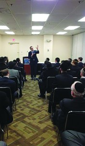 Rabbi Charlie Harary speaking at the Parnassah Expo. (Lakewood Scoop)
