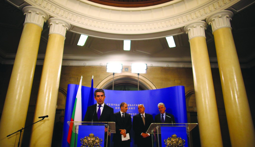 Bulgaria's President Rosen Plevneliev (L) speaks during a joint news conference with Prime Minister Boiko Borisov (2nd R) and Interior Minister Tsvetan Tsvetanov (2nd L) in Sofia. They said that two individuals with links to Hizbullah were involved in a bomb attack on a bus in the Bulgarian resort of Burgas that killed five Israeli tourists last July. (REUTERS)
