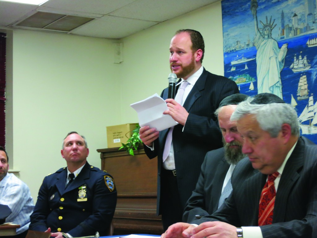 At Tuesday's CB 12 meeting, Councilman Greenfield explains his opposition to ShopRite's proposal to connect its parking lot to the dead-end at 19th Avenue. L-R: CB 12 memer Mottie Katz (partial view); NYPD Deputy Inspector Michael Deddo, Councilman David Greenfield, 2nd vice chair of CB 12 Yeruchim Silber, first vice chair CB 12 Moshe Wieder.