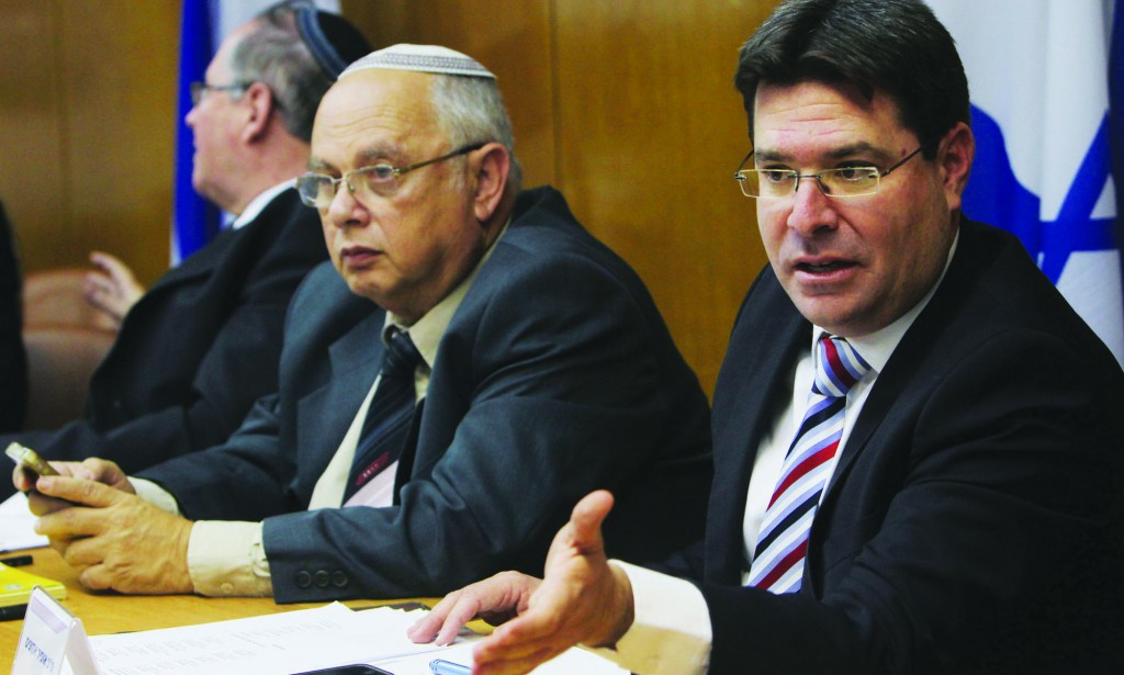 'Coercion is not the way.' Likud MK Ofir Akunis (R), a member of the Israel Elections Committee in a meeting ahead of the recent elections. (FLASH90)