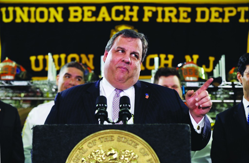 New Jersey Gov. Chris Christie feigns a stern look Tuesday, Feb. 5, in Union Beach, N.J., after his was playfully asked about his weight. (AP Photo/Mel Evans)