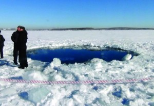 A circular hole in the ice of Chebarkul Lake, where a meteorite reportedly struck the lake near Chelyabinsk, about 1,500 kilometers east of Moscow, Russia, Friday. (AP Photo)