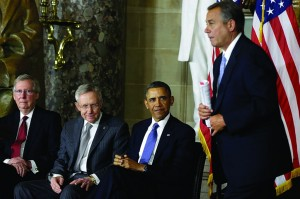 L-R: Sen. Minority Leader Mitch McConnell, Sen. Majority Leader Harry Reid, and President Obama sit as Rep. John Boehner walks to the podium to speak at the unveiling of a statue of Rosa Parks, Wednesday, in Washington. (AP Photo/Charles Dharapak)