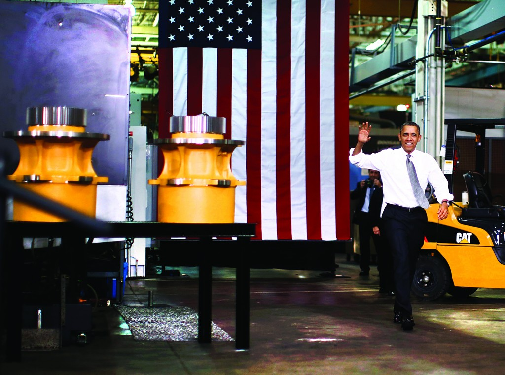 President Barack Obama waves before his remarks on the economy, after his tour of Linamar Corporation that manufactures parts for the truck industry, in Arden, North Carolina, Wednesday. (REUTERS/Jason Reed)