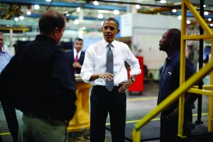 U.S. President Barack Obama meets with workers as he tours Linamar Corporation, a manufacturer of parts for the truck industry in Arden, North Carolina. (REUTERS/Jason Reed)