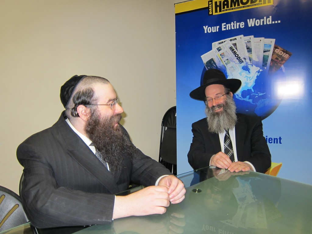 Bnei Brak Mayor Avraham Rubinstein (R) yesterday at Hamodia's office in Brooklyn with Yochonon Donn.