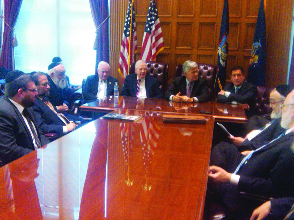 At the Capitol (L-R), at the head of the table, Senator John Flanagan, Senator Kemp Hannon, Senate Majority Leader Dean Skelos, Senator Jeff Klein. (Shimon Golding)