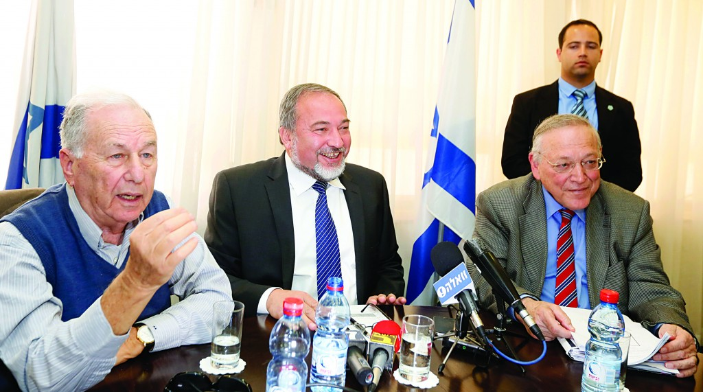 (L-R:) Professor Amnon Rubinstein, Israel's former foreign minister Avigdor Lieberman and professor of law Uriel Reichman during a press conference about changing the system of government in the Israeli Knesset yesterday. (Miriam Alster/FLASH90)