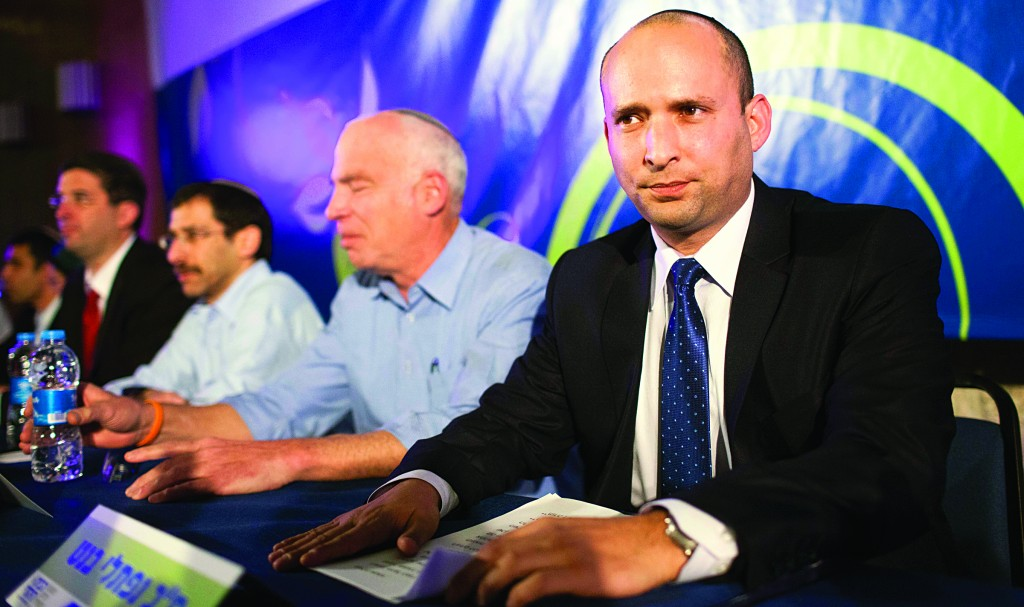 Jewish Home Chairman Naftali Bennett (far right) at a party conference Wednesday night. (Flash90)