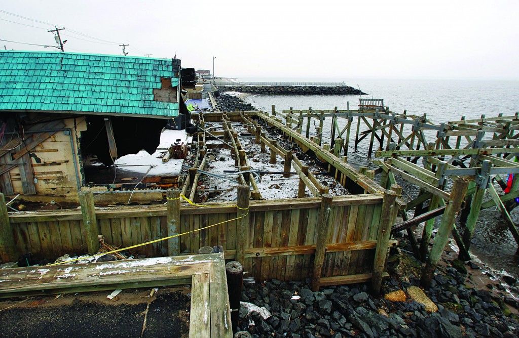 "Heavily damaged by Superstorm Sandy, Jakeabob's Bay restaurant and piers are seen Tuesday in Union Beach, N.J. Gov. Christie told a gathering there that the National Flood Insurance Program's handling of claims in New Jersey ""has stunk."" (AP Photo/Mel Evans)"
