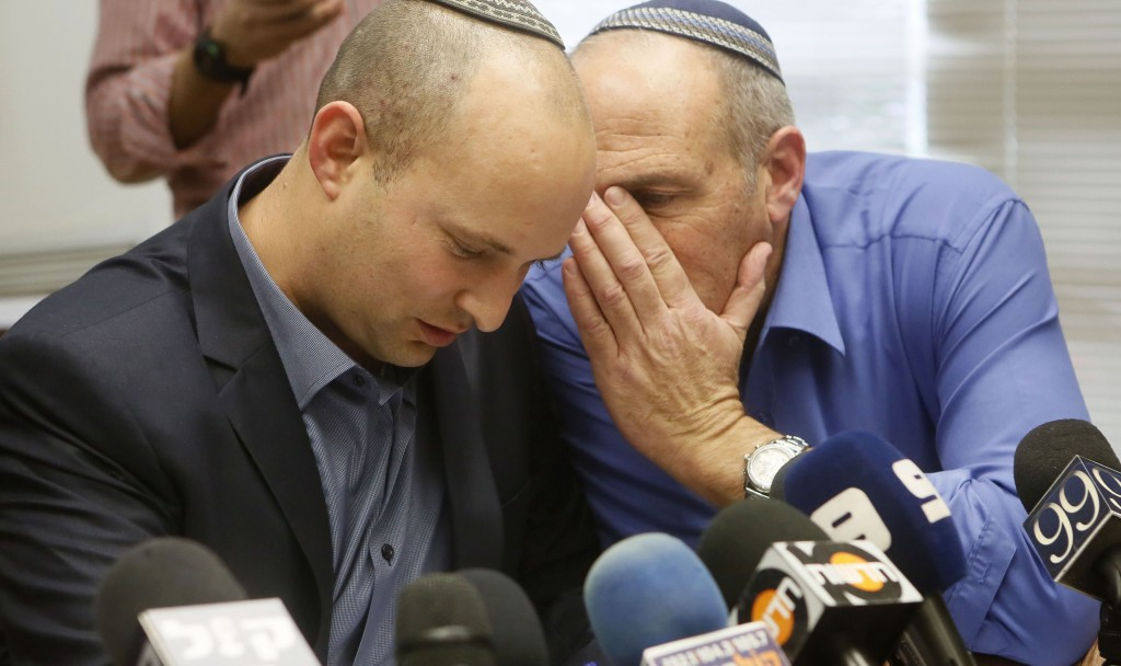 Jewish Home leader Naftali Bennett (L) with fellow MK Mordechi Yogev during a party meeting in the Knesset on Monday. (FLASH90)