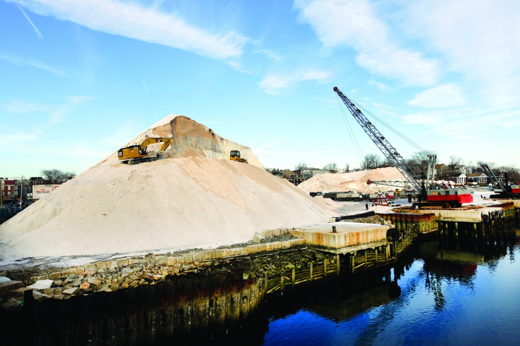 Work continues on large salt piles at Eastern Salt Company in Chelsea, Mass., Thursday in preparation for a major winter storm headed toward the Northeast. (AP Photo/Elise Amendola)