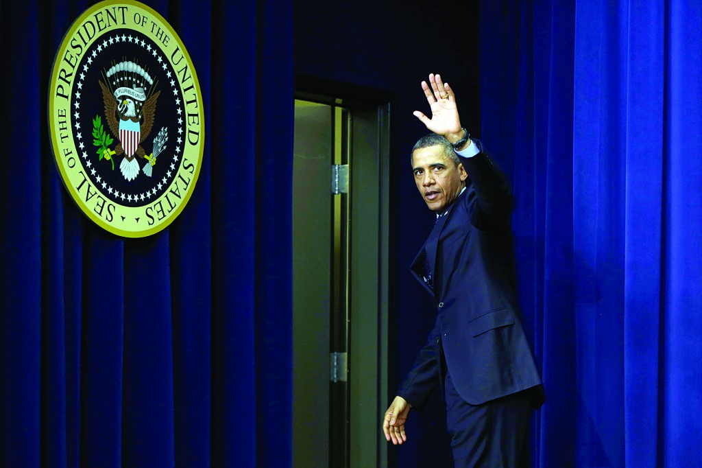 President Barack Obama waves as he leaves the South Court Auditorium of the Eisenhower Executive Office building on the White House complex in Washington, Tuesday, after he spoke about the sequester. (AP Photo/Charles Dharapak)