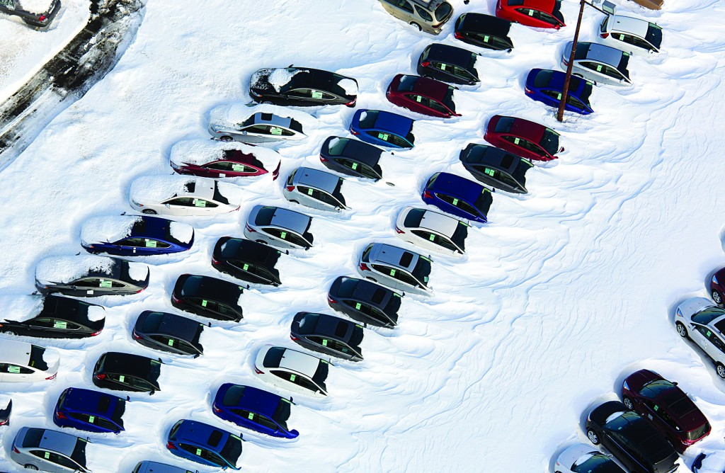 Neighborhoods and cars are buried in snow near New Haven, Conn., on Sunday. (AP Photo/Craig Ruttle)