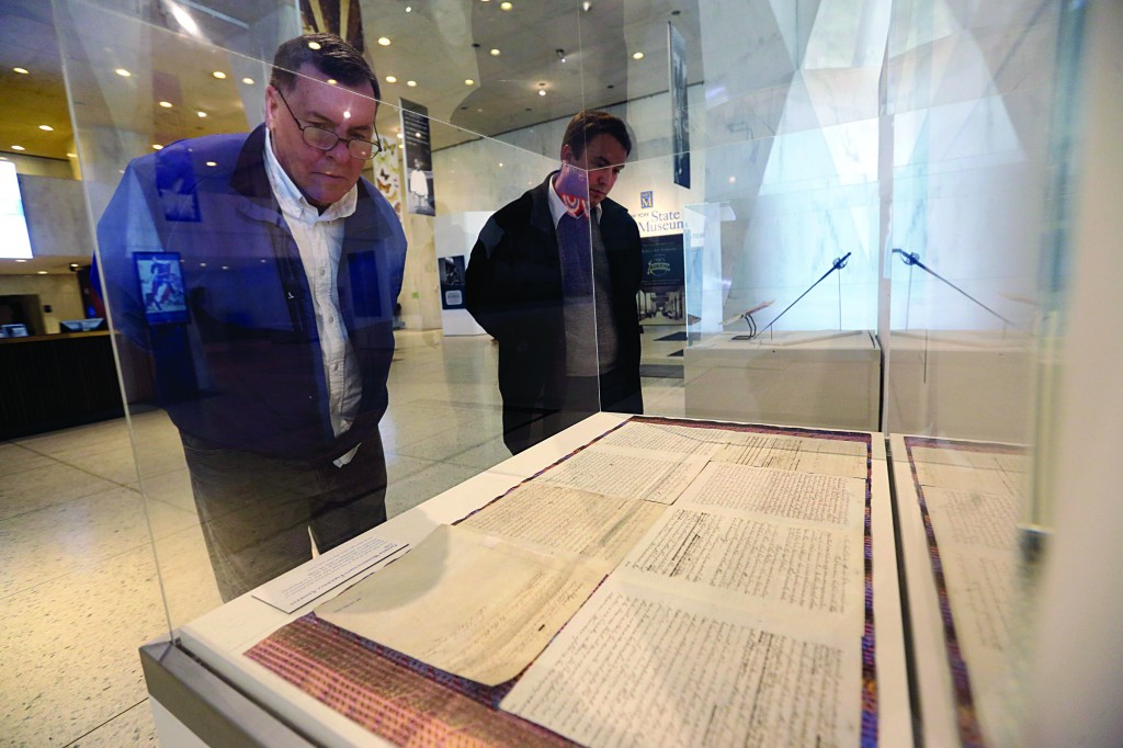 Tom Capstraw (L) and Zach Warner, both of Albany, look at George Washington's farewell address, written in his own hand, on display at the New York State Museum on Friday in Albany, N.Y. The document is part of a Presidents' Weekend exhibit of New York residents who became president. The exhibit honors Washington, the nation's first president, Martin Van Buren, Millard Fillmore, Chester A. Arthur, Ulysses S. Grant, Grover Cleveland, and Theodore and Franklin Roosevelt. (APPhoto/Mike Groll)
