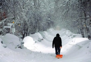 A man drags a shovel up Beacon Hill during a severe winter snow storm in Boston, Massachusetts. (REUTERS/Brian Snyder)