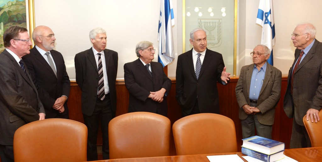 Israeli Prime Minister Binyamin Netanyahu meets with Judge Jacob Turkel (C) and other members of the Turkel committee at Netanyahu's office on Wednesday as they handed in the final installment on their report on the Gaza flotilla mission of May 2010. (FLASH90)