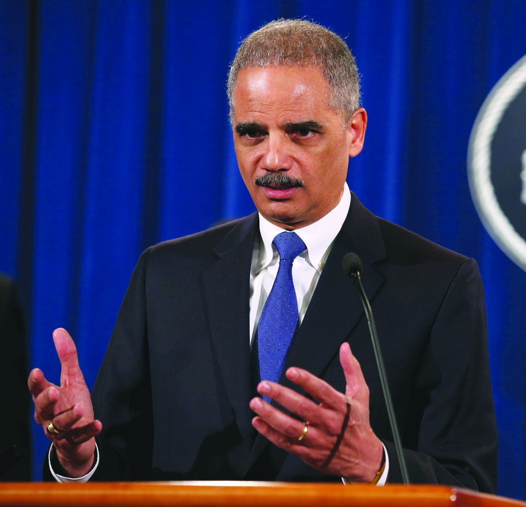 U.S. Attorney General Eric Holder leads a news conference with attorneys general from eight states and the District of Columbia at the Department of Justice Tuesday. (Chip Somodevilla/Getty Images)