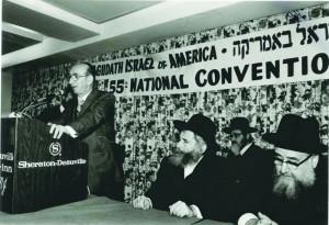 R-L:  Harav Shimon Schwab; the Gerrer Rebbe the Pnei Menachem; Rabbi Yosef Friedenson, speaking at an Agudah convention.