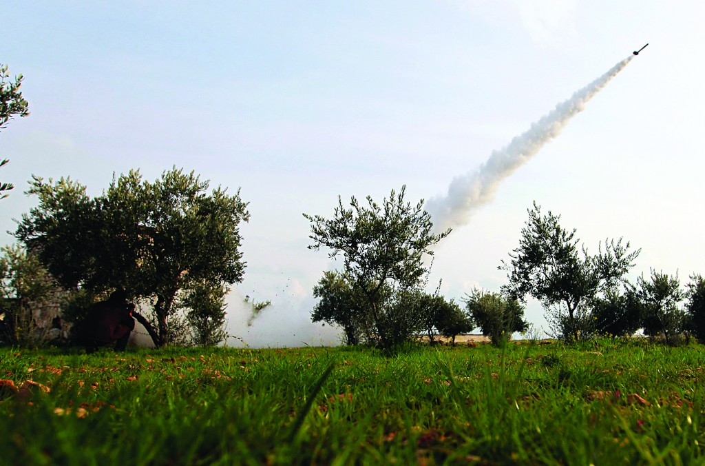 A rocket is launched by Free Syrian Army fighters towards Nairab military airport and the international airport, which are controlled by forces loyal to Syria's President Bashar al-Assad in Aleppo, Tuesday. (REUTERS/Muzaffar Salman)