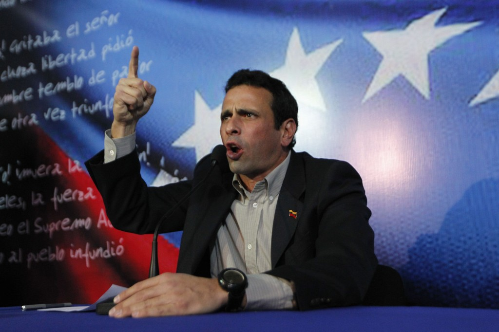 Henrique Capriles, Venezuela's opposition leader and governor of Miranda state, addresses the media in Caracas on Sunday. (REUTERS/Carlos Garcia Rawlins)