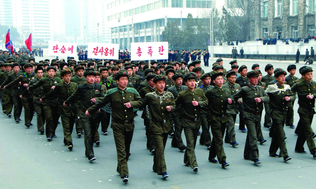 North Korean students attend a contest of singing wartime songs in chorus while marching in array, at Kim Il-Sung square in Pyongyang in this picture released by the North's KCNA news agency on Sunday. KCNA said more than 10,000 students from 14 universities and 11 districts attended the contest. (REUTERS/KCNA)